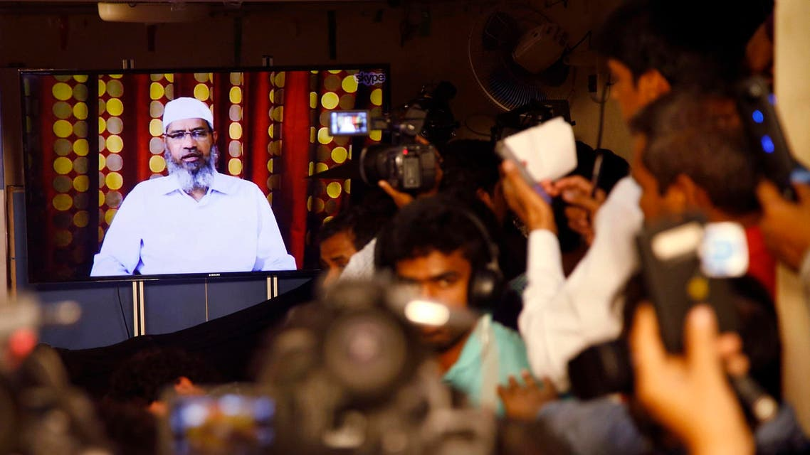 Indian journalists listen to a video conference of Zakir Naik in Mumbai on July 15, 2016. (AP)
