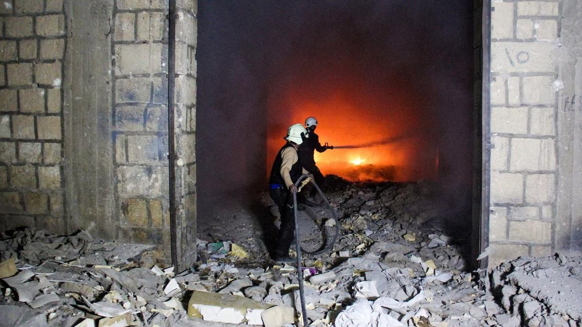 Syrian civil defence volunteers, known as the White Helmets, try to extinguish fire reportedly caused by air strikes in Idlib. (File photo: AFP)