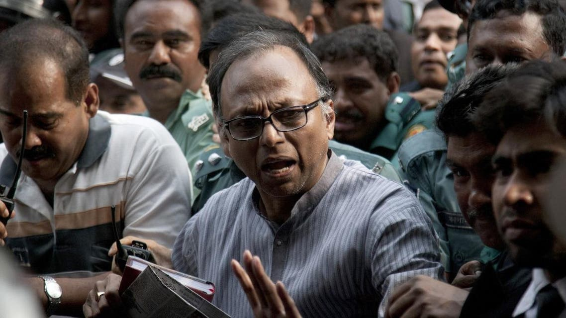 Pro-opposition Bangladeshi newspaper editor Mahmudur Rahman appears in court following his arrest in Dhaka on April 11, 2013. (AFP)