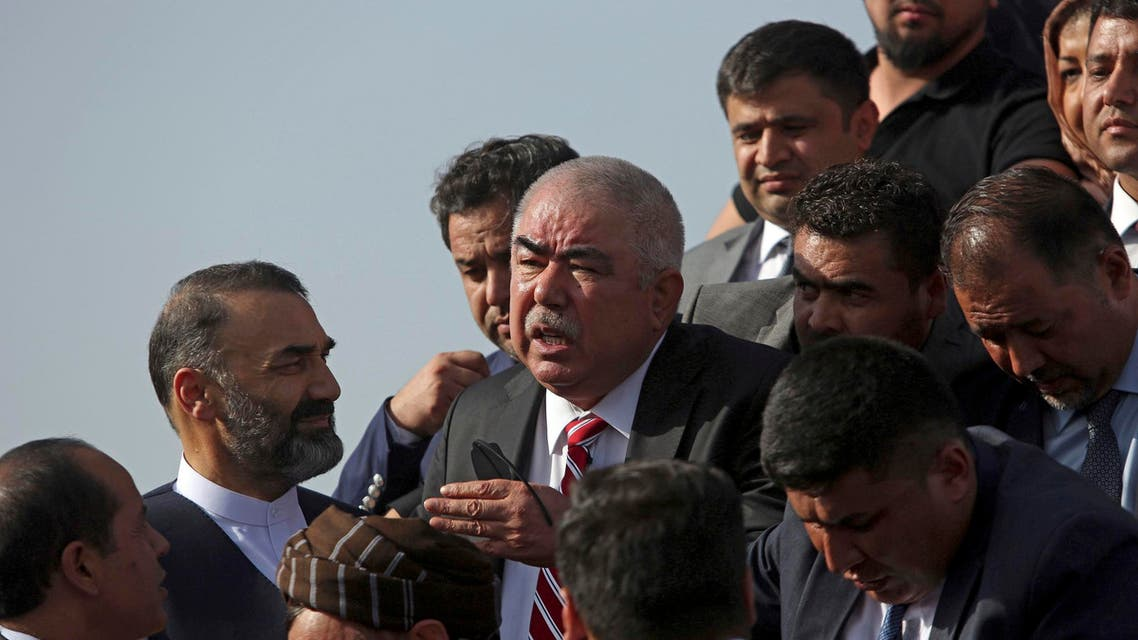 Gen. Abdul Rashid Dostum, center, and members of his entourage disembark on arrival at Kabul International Airport in Kabul, Afghanistan, Sunday, July 22, 2018. (AP)