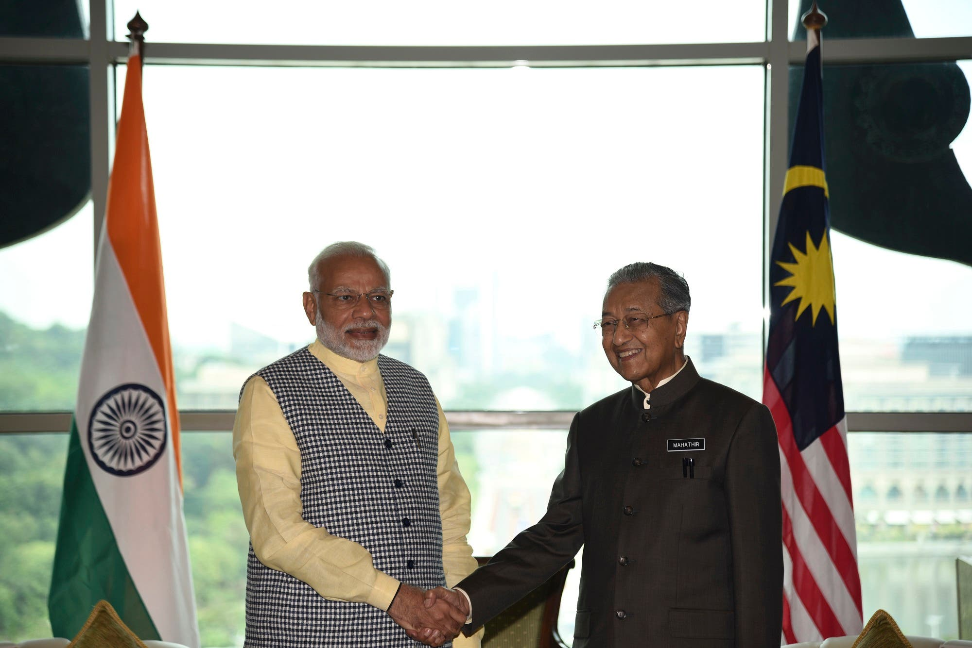 Prime Minister Narendra Modi, left, poses with Malaysia's Prime Minister Mahathir Mohamad in Putrajaya, Malaysia, on May 31, 2018. (Malaysia Information Ministry via AP)