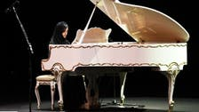 Saudi pianist holds her own as she shares stage with world's youngest violinist