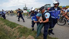 Tour de France briefly interrupted by farmers' protest
