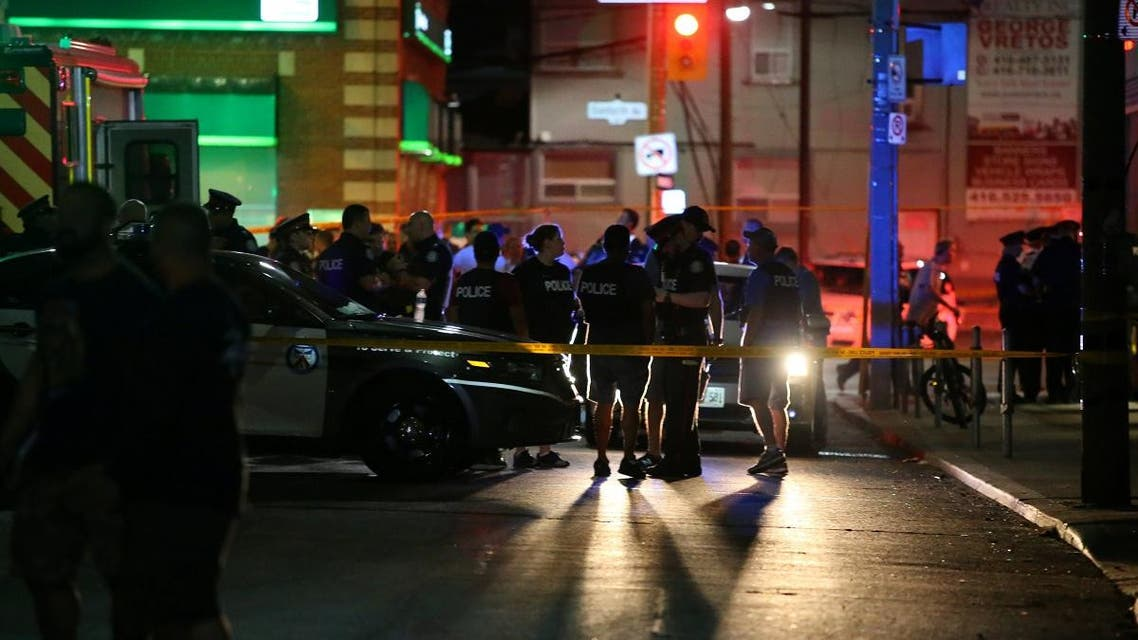 Police are seen near the scene of a mass shooting in Toronto. (Reuters)