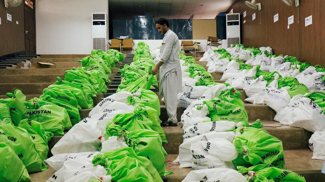 A worker arranges sacks of election materials for distribution among electoral workers, at a distribution point, ahead of general election in Peshawar. (Reuters)