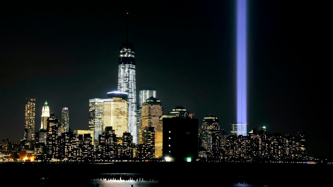 """The """"Tribute in Light"""" shines from the Manhattan skyline next to One World Trade Center on 9/11 on September 11, 2013 in Hoboken, New Jersey. (AFP)"""