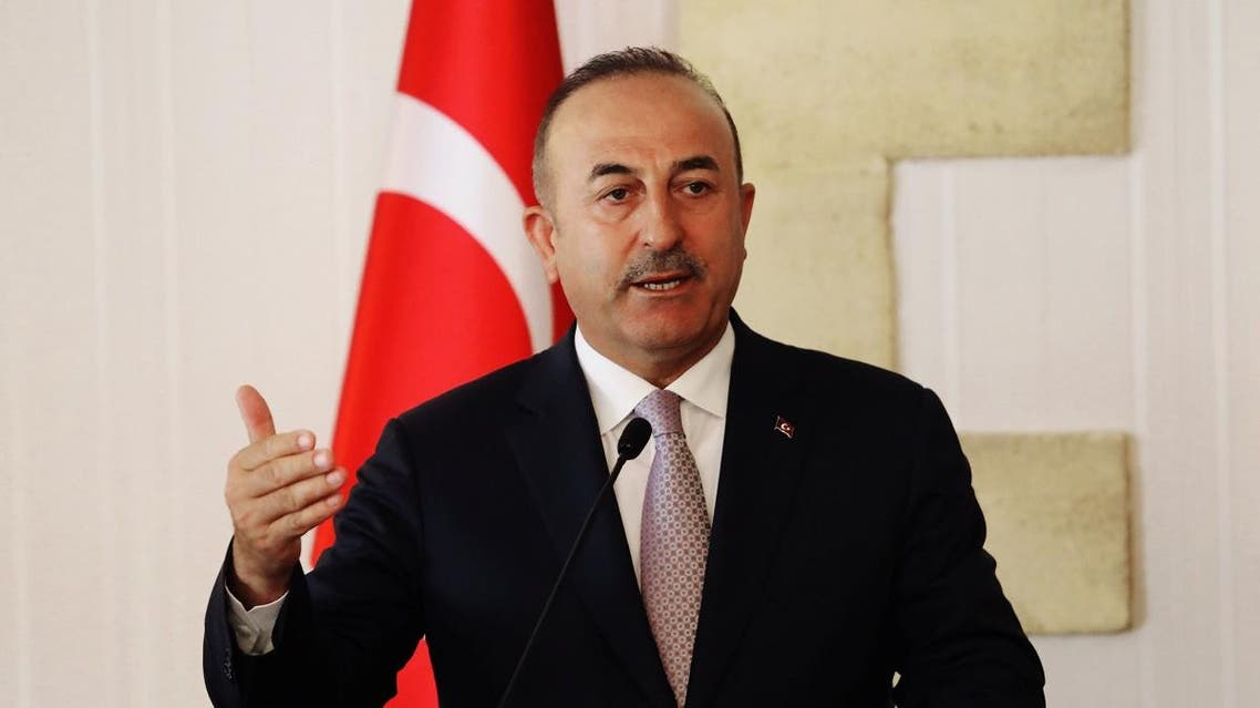 Turkey's Foreign Minister Mevlut Cavusoglu talks at a press conference during a visit in the Turkish Cypriot northern part of the divided city of Nicosia. (Reuters)