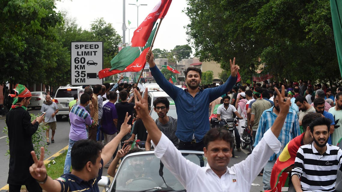 Supporters of Imran Khan's Pakistan Tehreek-e-Insaf take to the street to celebrate after polls closed in Lahore on July 25, 2018. (AFP)