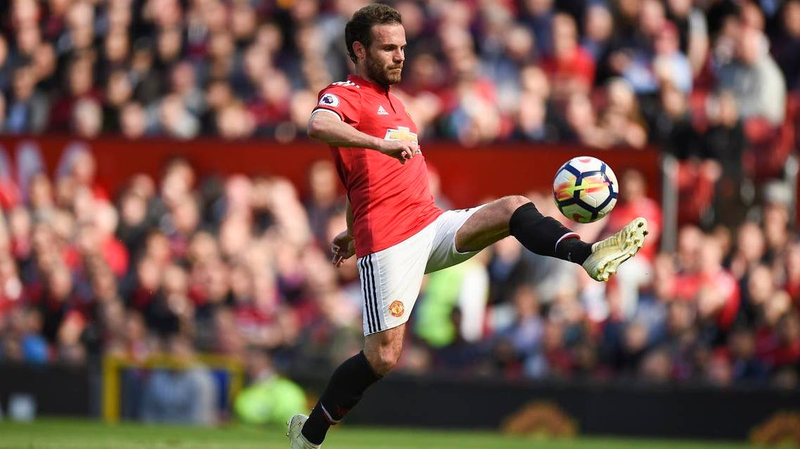 Manchester United's Spanish midfielder Juan Mata controls the ball during the English Premier League football match between Manchester United and Watford at Old Trafford in Manchester, north west England. (AFP)