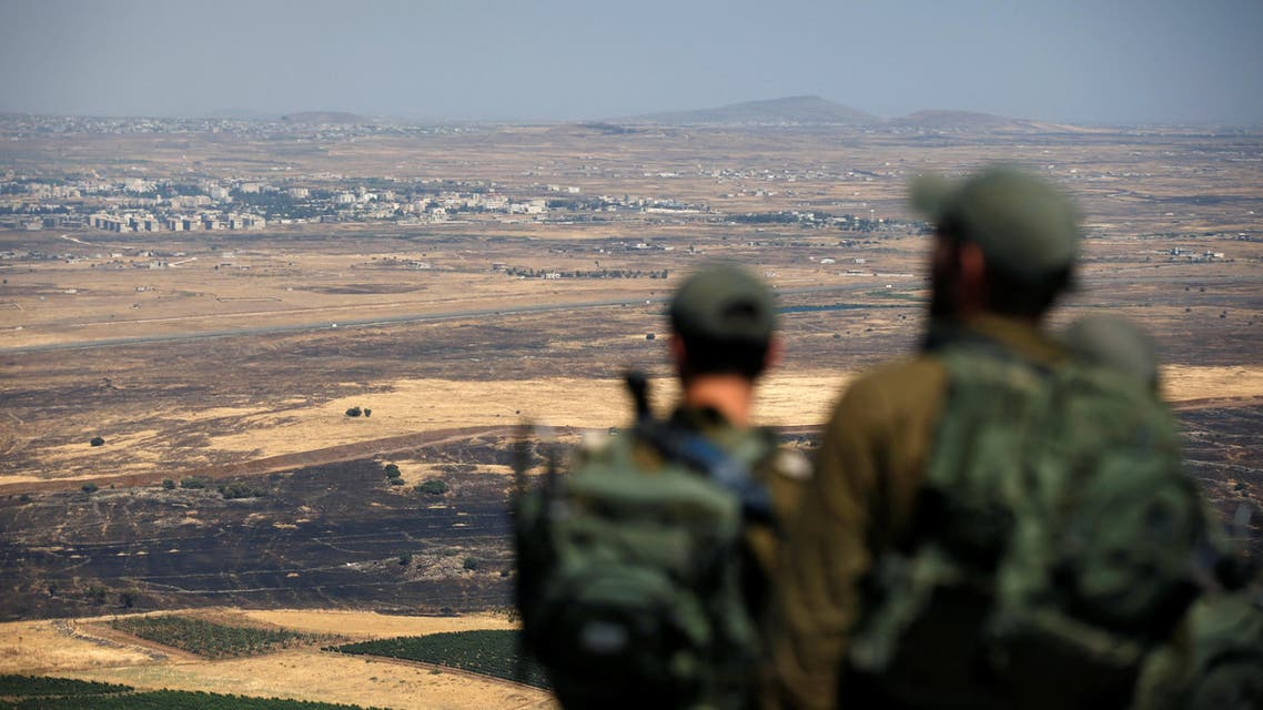 Israeli soldiers look at the Syrian side of the Israel-Syria border on the Israeli-occupied Golan Heights, Israel July 7, 2018. REUTERS/Ronen Zvulun
