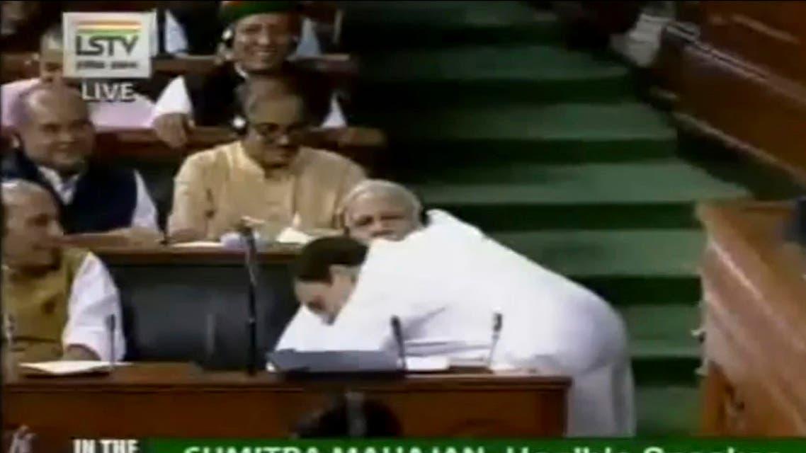 Rahul Gandhi hugging Prime Minister Modi during parliament proceedings in New Delhi on July 20, 2018. (Lok Sabha Television via AP)