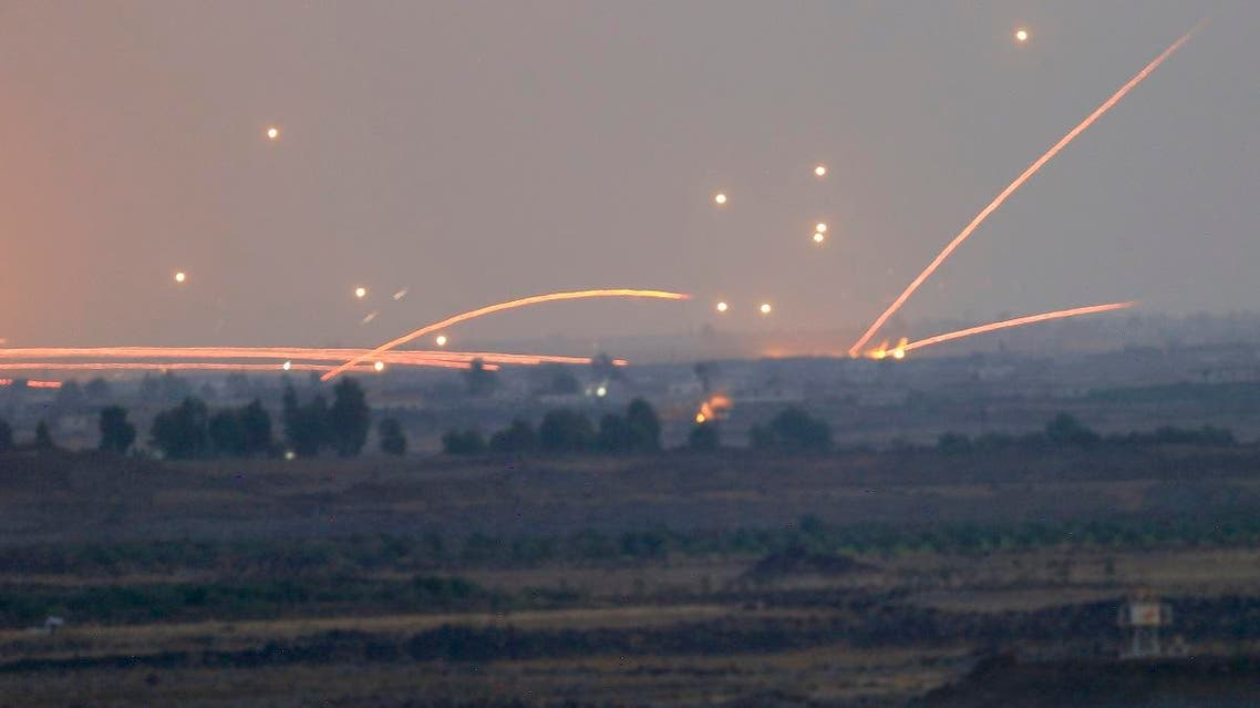 Fire trails and explosions from the fighting between Syrian regime forces and rebels in southern Syria as seen from the Israeli-controlled Golan Heights, on July 25, 2018. (AP)
