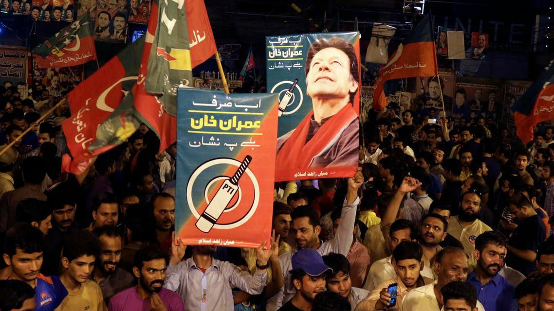 Supporters of Imran Khan celebrate unofficial results in Islamabad on July 25, 2018. (AP)