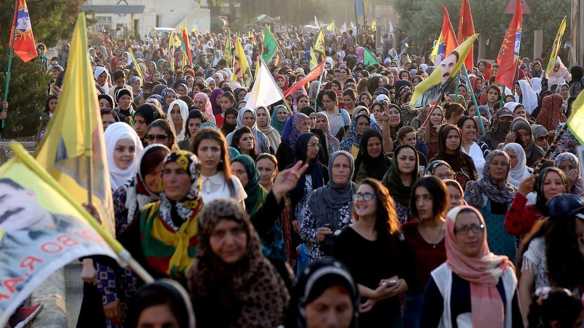 Syrian-Kurdish demonstrators wave Kurdish flag during a protest in Qamishli on June 23, 2018. (AFP)