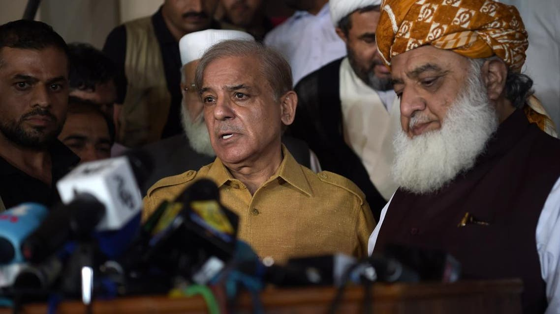 Shahbaz Sharif (L), the younger brother of ousted Pakistani Prime Minister Nawaz Sharif and head of Pakistan Muslim League-Nawaz (PML-N), speaks during a press conference as Pakistani opposition leader Maulana Fazalur Rehman (R) listens on after attending an All Parties Conference in Islamabad on July 27, 2018. (AFP)