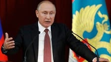 Putin signs laws against fake news, 'disrespecting' authorities