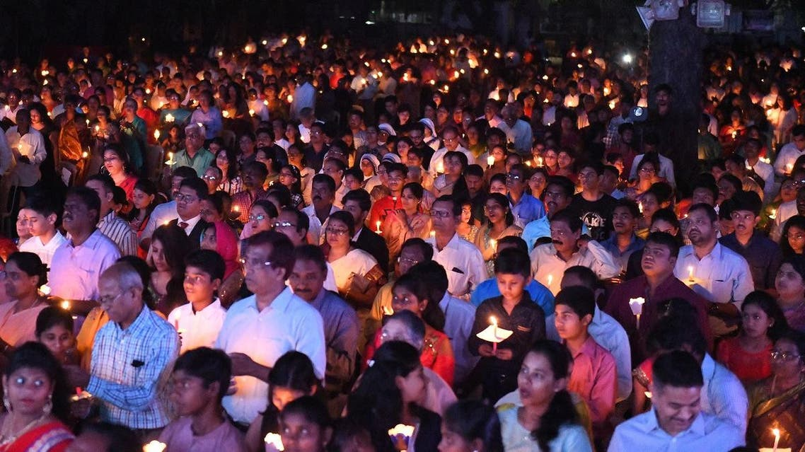 File photo of Indian Catholic Christians attending a midnight Easter vigil mass. (AFP)