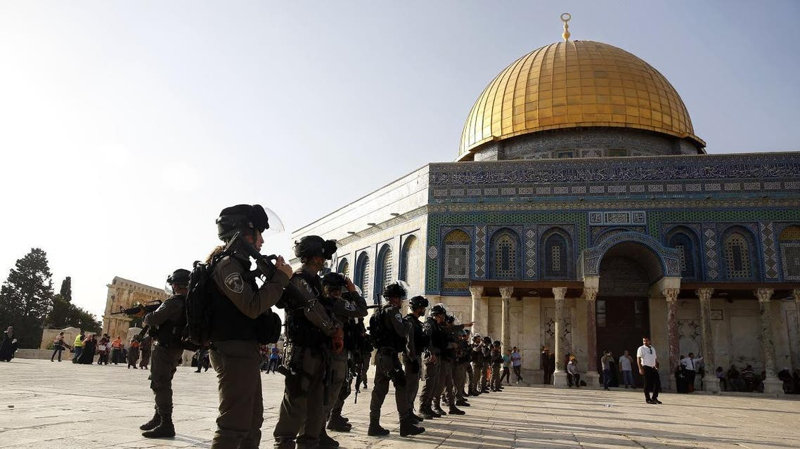 Israeli border police officers stand near the Dome of the Rock Mosque in the Al Aqsa Mosque compound in Jerusalem's Old City, Thursday, July 27, 2017.(AP)