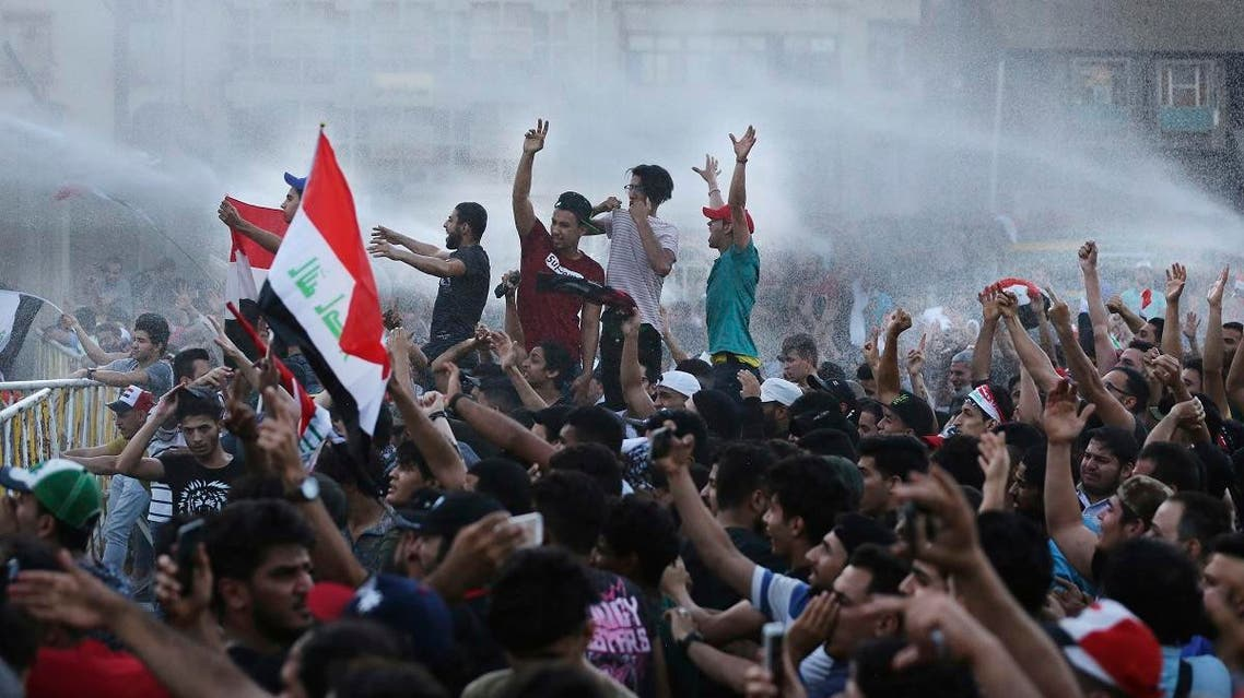 Protesters demand better public services and jobs during a demonstration in Tahrir Square in central Baghdad, Iraq, Friday, July 20, 2018. (AP)