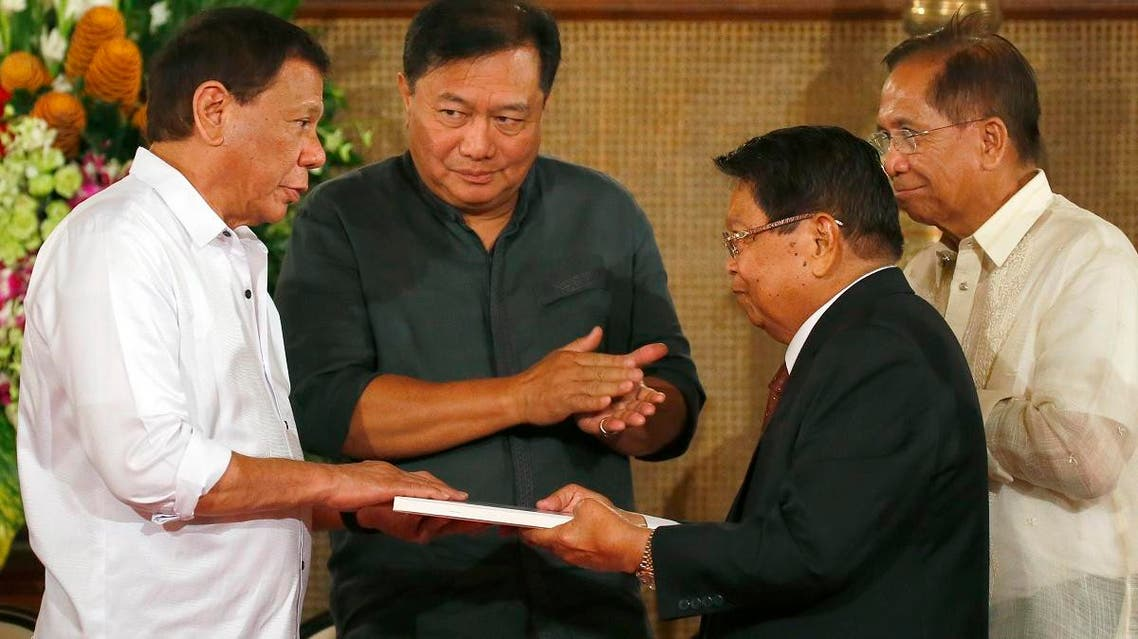 Philippine President Rodrigo Duterte, left, receives the draft of the Bangsamoro Basic Law from Ghazali Jaafar, vice-chair of the Moro Islamic Liberation Front (MILF), during a ceremony at Malacanang Palace Monday, July 17, 2017 in Manila, Philippines. (AP)