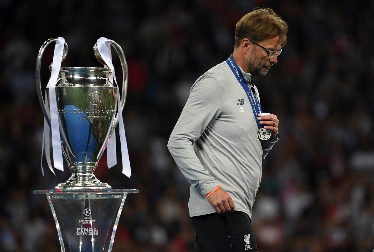 Liverpool's Jurgen Klopp walks past the trophy as he collects his loser's medal after the UEFA Champions League final football match between Liverpool and Real Madrid in Kiev, Ukraine on May 26, 2018. (AFP)