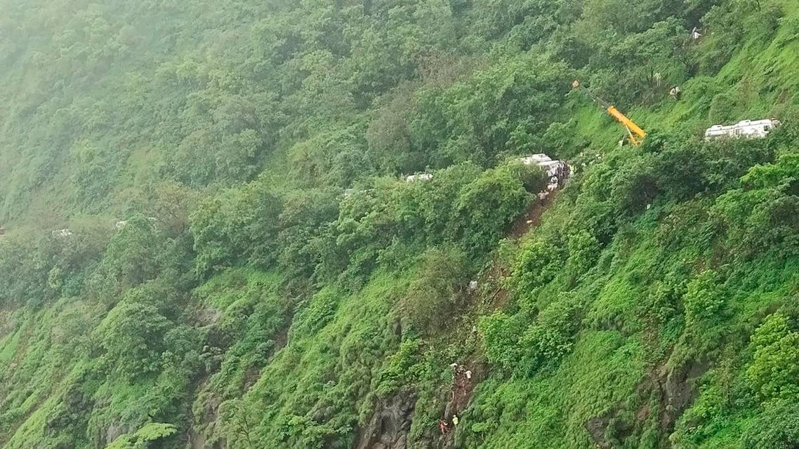 Rescuers work at the site of an accident in Raigad district in the western Indian state of Maharashtra, on Saturday, July 28, 2018. (AP)