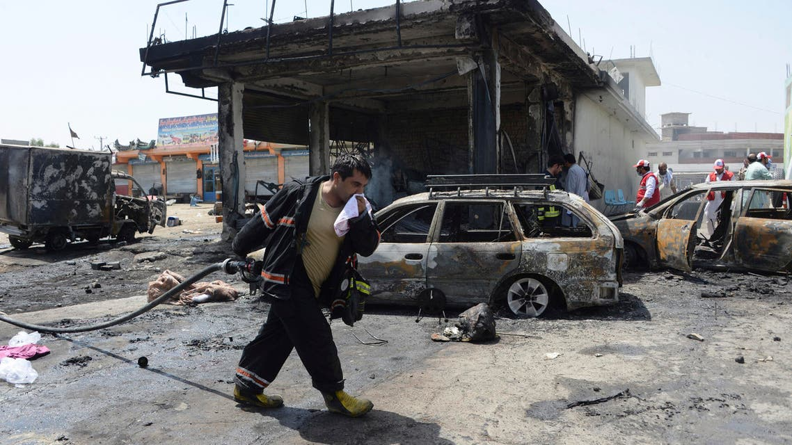 Firefighters work at the site of a deadly suicide attack in Jalalabad, the capital of Nangarhar province, Afghanistan, Tuesday, July 10, 2018. (AP)