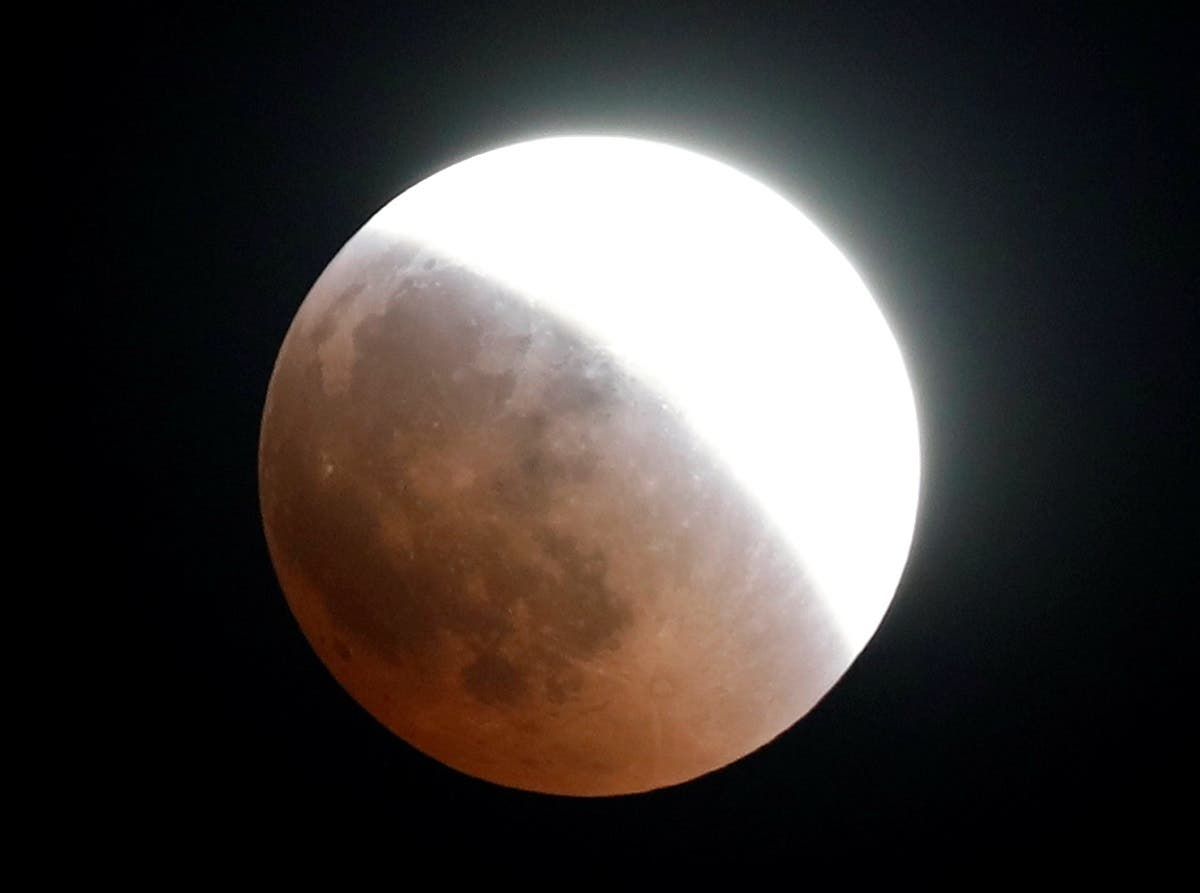 "A ""Super Blue Blood Moon"" rises during the lunar eclipse over Cairo, Egypt, on July 27, 2018. (Reuters)"