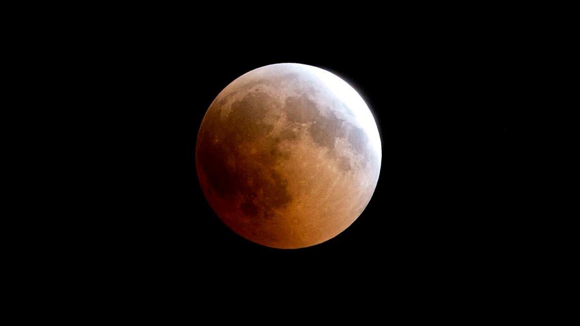 A blood moon rises over Gaza City, Friday, July 27, 2018. (AP)