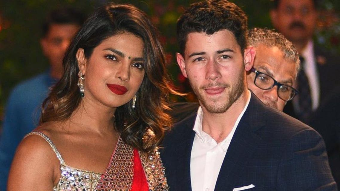 Indian Bollywood actress Priyanka Chopra (L) accompanied by Nick Jonas arrive for the pre-engagement party of India's richest man and Reliance Industries Limited Chairman, Mukesh Ambani's eldest son Akash Ambani and fiancee Shloka Mehta in Mumbai on June 28, 2018. (AFP)