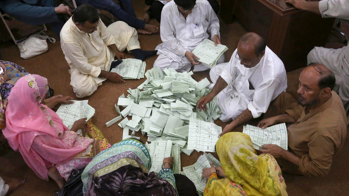 Pakistani election staff count the votes following polls closed at a polling station for the parliamentary elections in Karachi, Pakistan, Wednesday, July 25, 2018. (AP)
