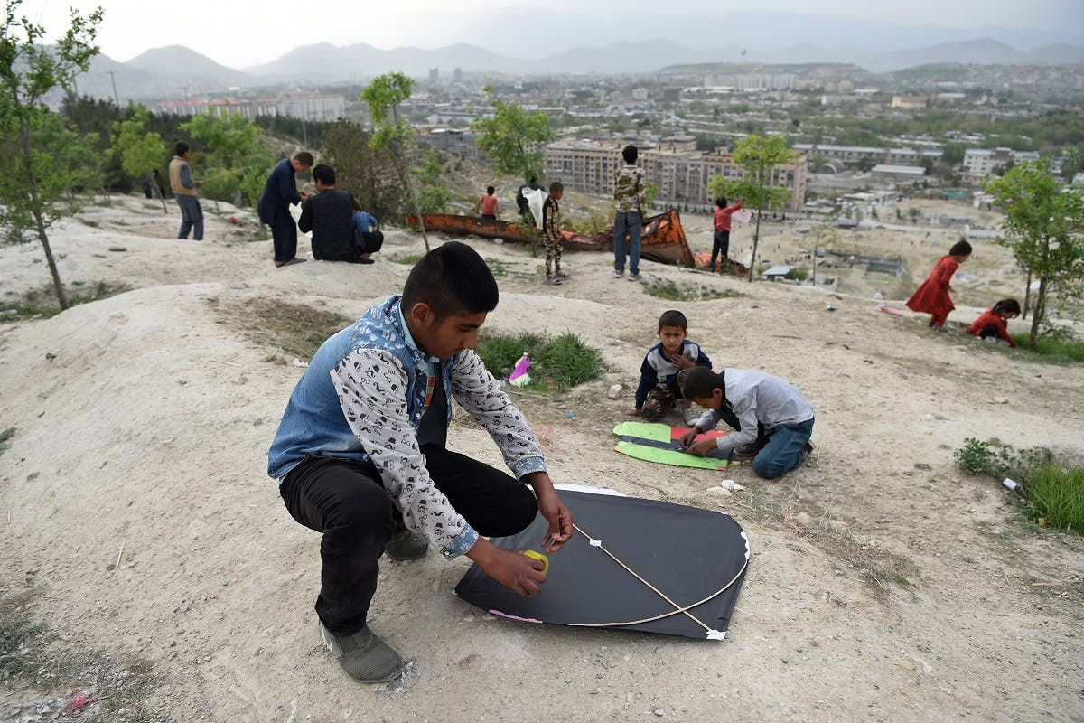 Afghan boys prepare to fly kites during a kite battle on a hillside in Kabul. After selling hundreds of thousands of kites during the cooler months, particularly in spring when flying conditions are ideal, kite makers spend the rest of the year replenishing their stocks. (AFP)