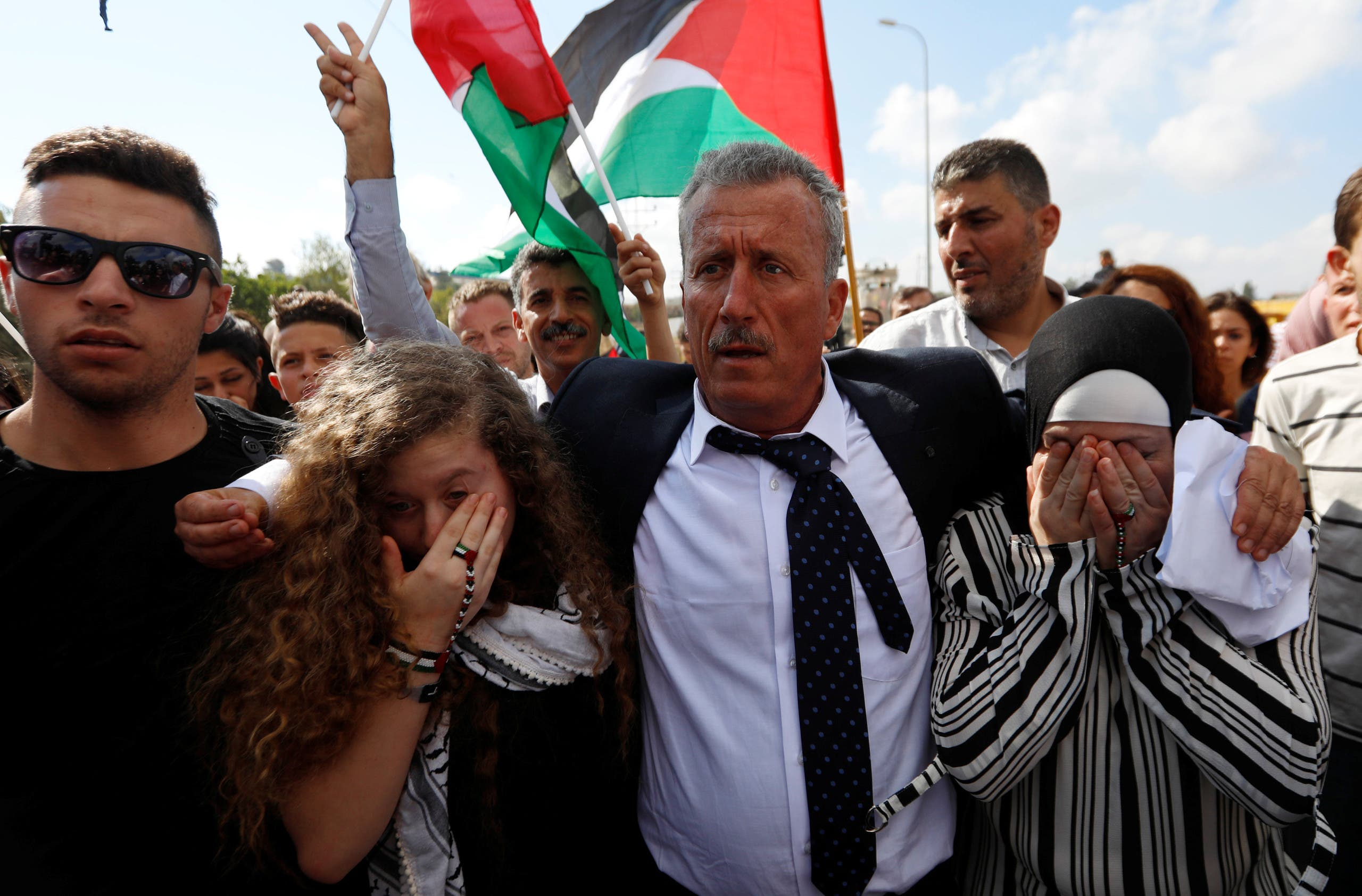Palestinian teenager Ahed Tamimi is welcomed by relatives and supporters after she was released from an Israeli prison. (Reuters)