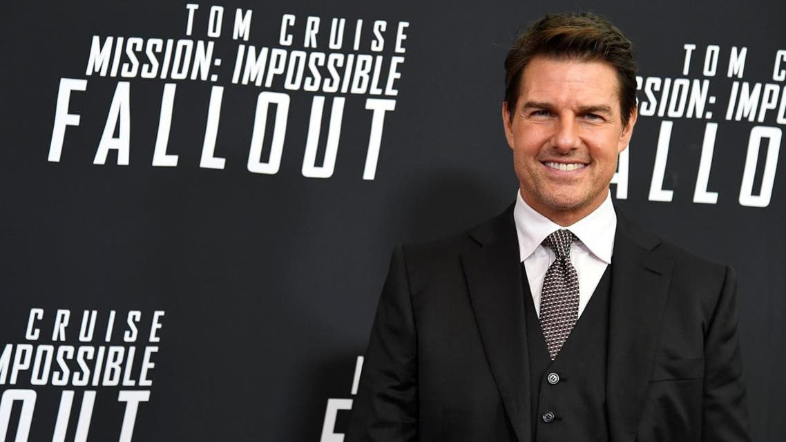 Tom Cruise arrives for Mission:Impossible film premiere in Washington. (Reuters)