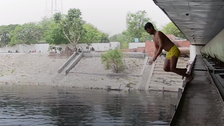 VIDEO: In India's capital, coin hunters dive to make a living