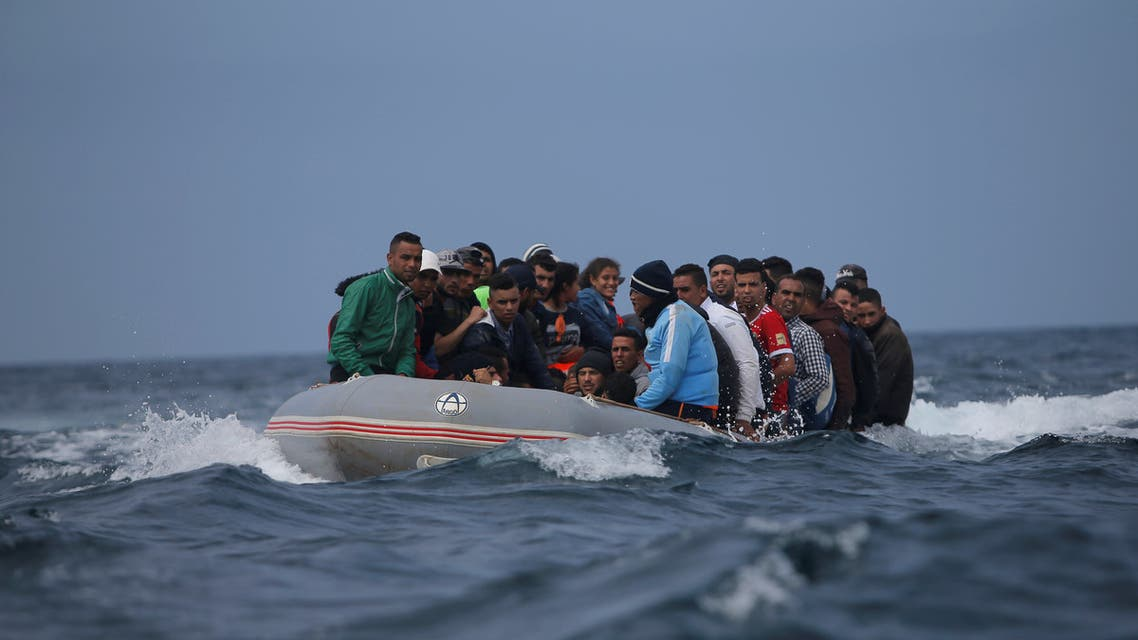 Migrants are seen before disembarking from a dinghy at Del Canuelo beach as they cross the Strait of Gibraltar sailing from the coast of Morocco, in Tarifa, southern Spain, July 27, 2018. REUTERS/Jon Nazca