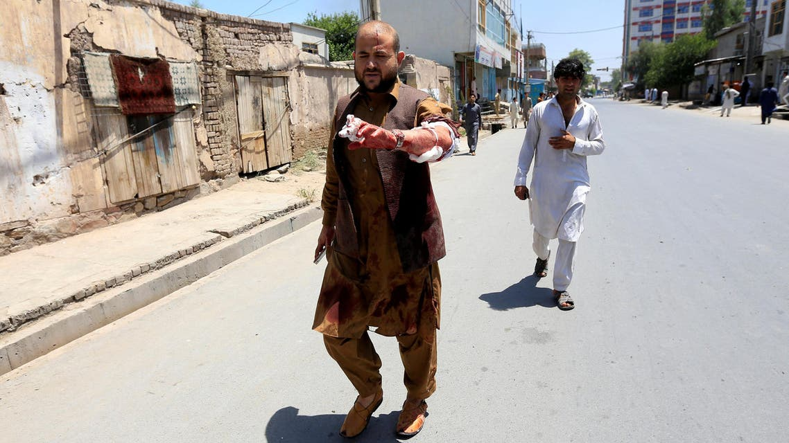 An injured man leaves the area where explosions and gunshots were heard in Jalalabad on July 31, 2018. (Reuters)