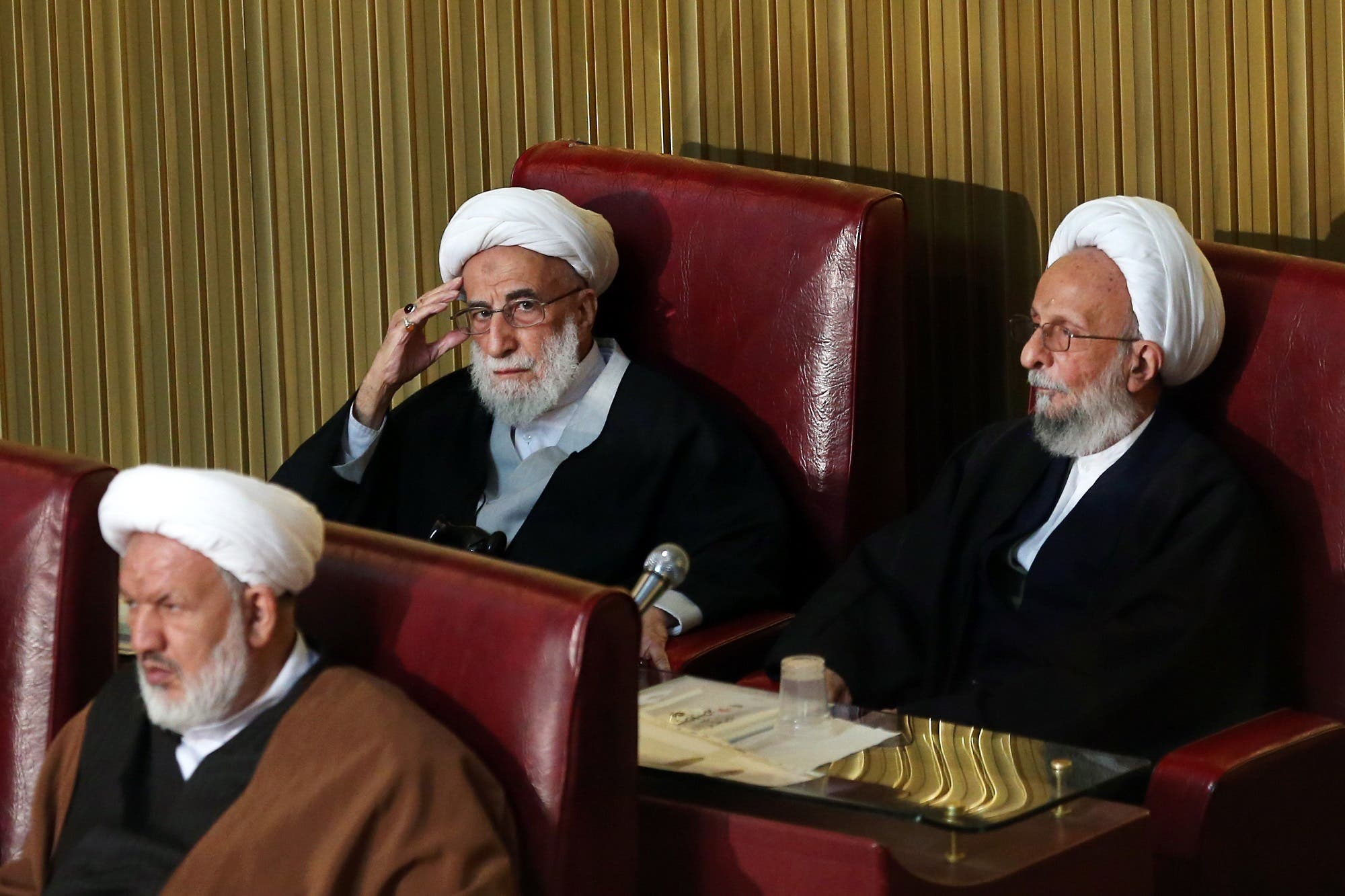 Ayatollah Ahmad Jannati, center, and Mesbah Yazdi, right, attend the fourth assembly in Tehran on March 8, 2016. (AP)