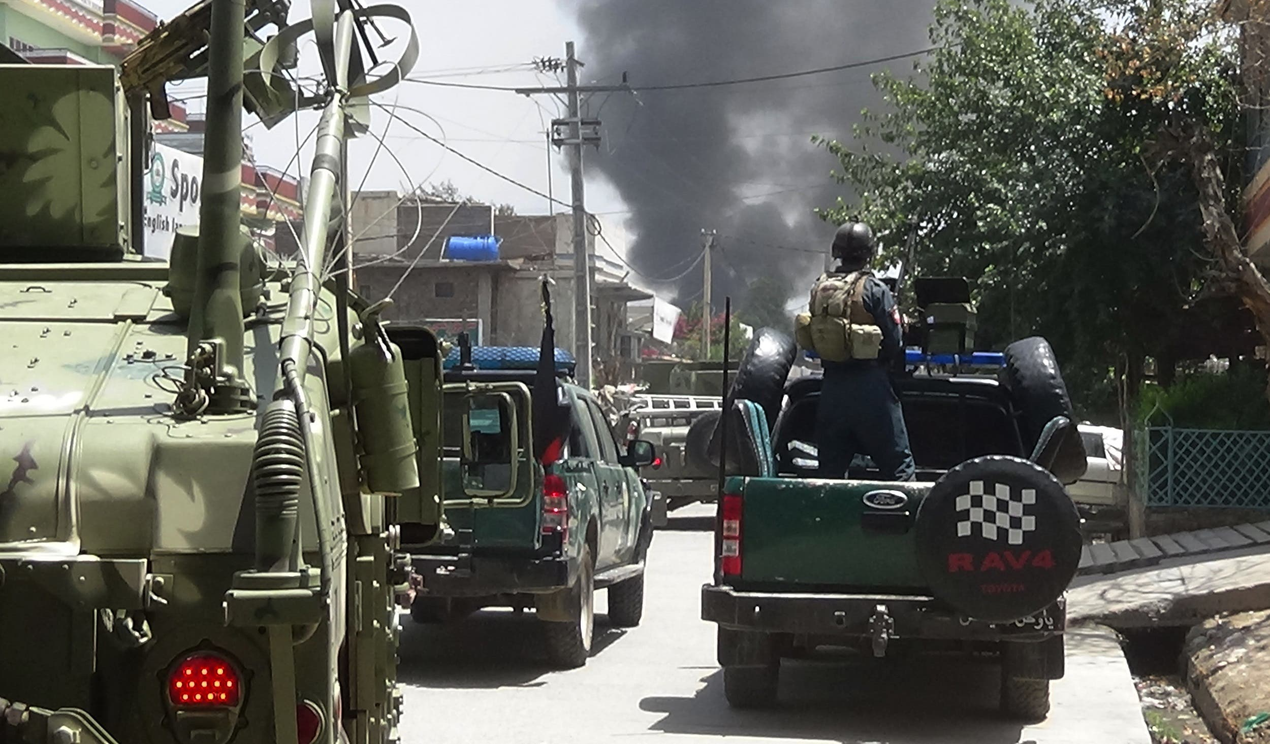 Afghan Security personnel arrive as smoke rises from the site of an attack in Jalalabad on July 28, 2018. (AFP)