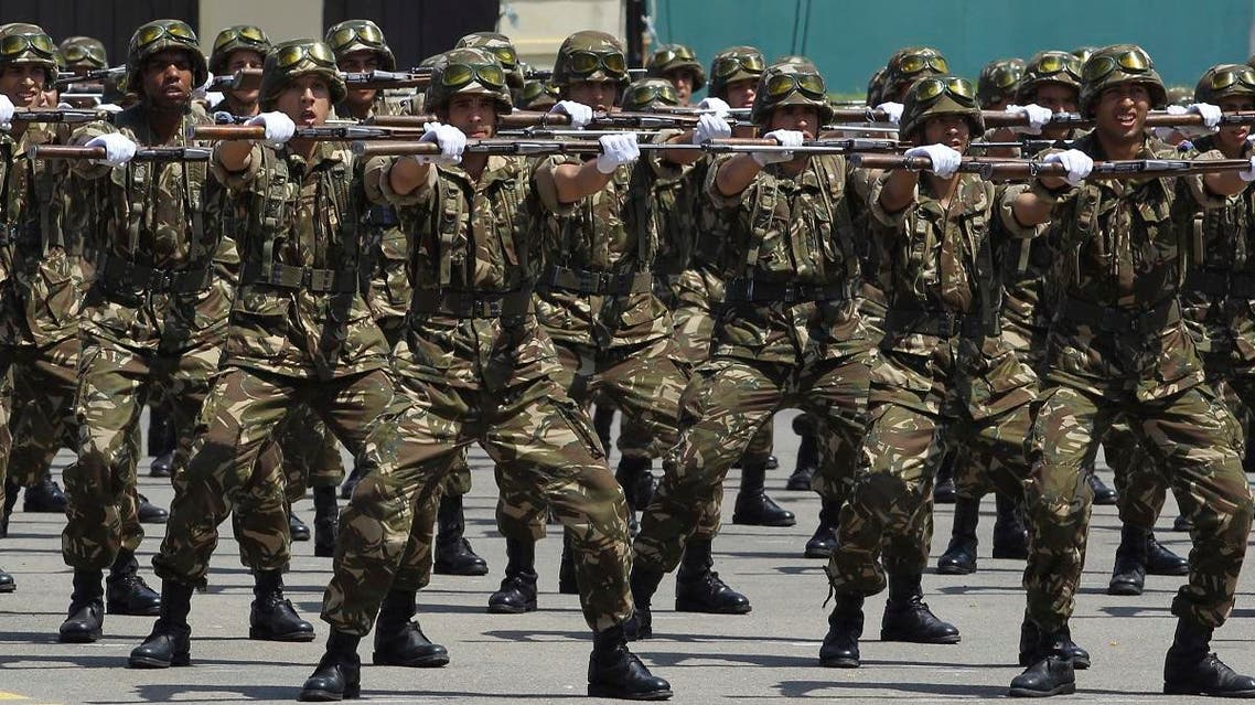 """Soldiers march during a military parade at the Cherchell """"Houari Boumediene"""" in Algiers, Sunday, July 1, 2018. (AP)"""