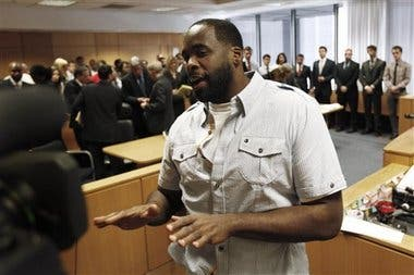 Former Detroit Mayor Kwame Kilpatrick speaks to the media while being led out of court in Detroit, Wednesday, June 15, 2011 AP