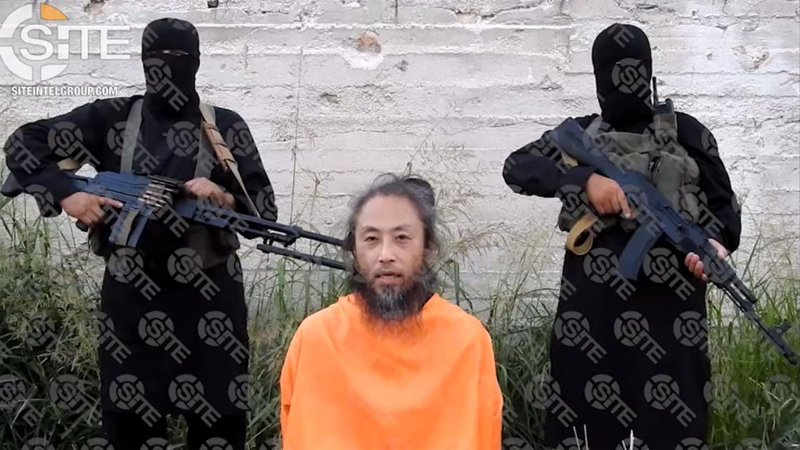 An extremist group has released videos of a Japanese journalist and an Italian man held captive in Syria in which they appeal for their release. (AFP)