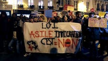 Despite opposition from left and right, France adopts law on asylum, immigration