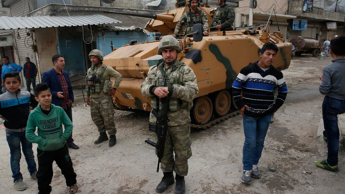 Turkish soldiers secure the streets of Afrin during a Turkish government-organized media tour into northern Syria on March 24, 2018. (AP)