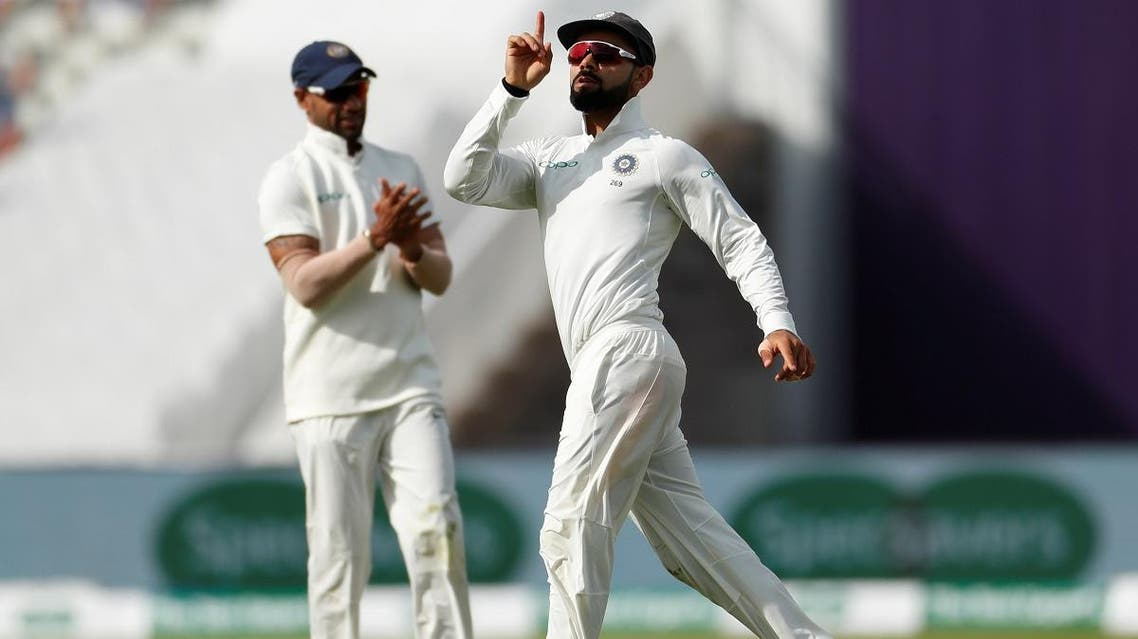 India's Virat Kohli celebrates after running out England's Joe Root in Birmingham on day one of the first test on August 1, 2018. (Reuters)