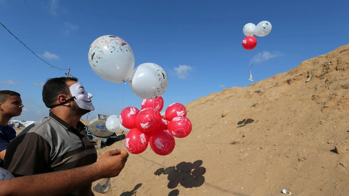 Palestinians fly balloons loaded with flammable material to be thrown at the Israeli side in Gaza on June 4, 2018. (Reuters)