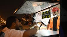 Burger on wheels: The cook behind the sizzling hot grill is a Saudi