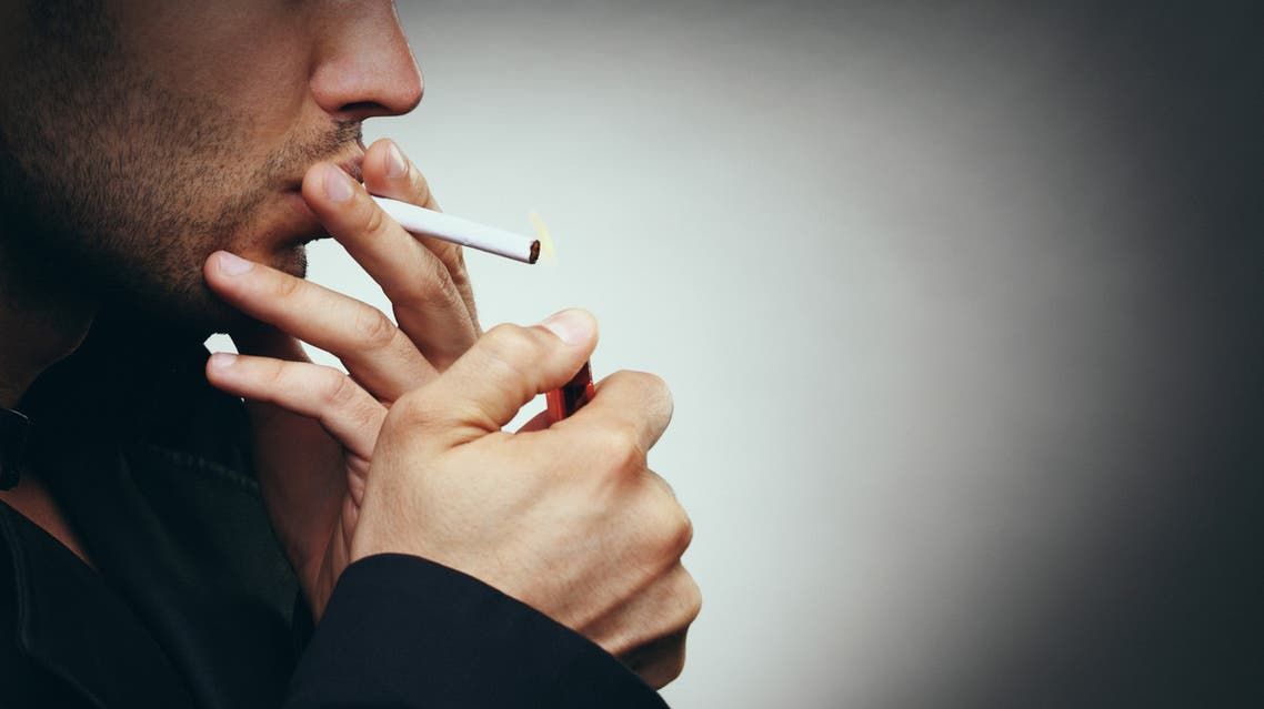 Smoking a cigarette. - Stock image