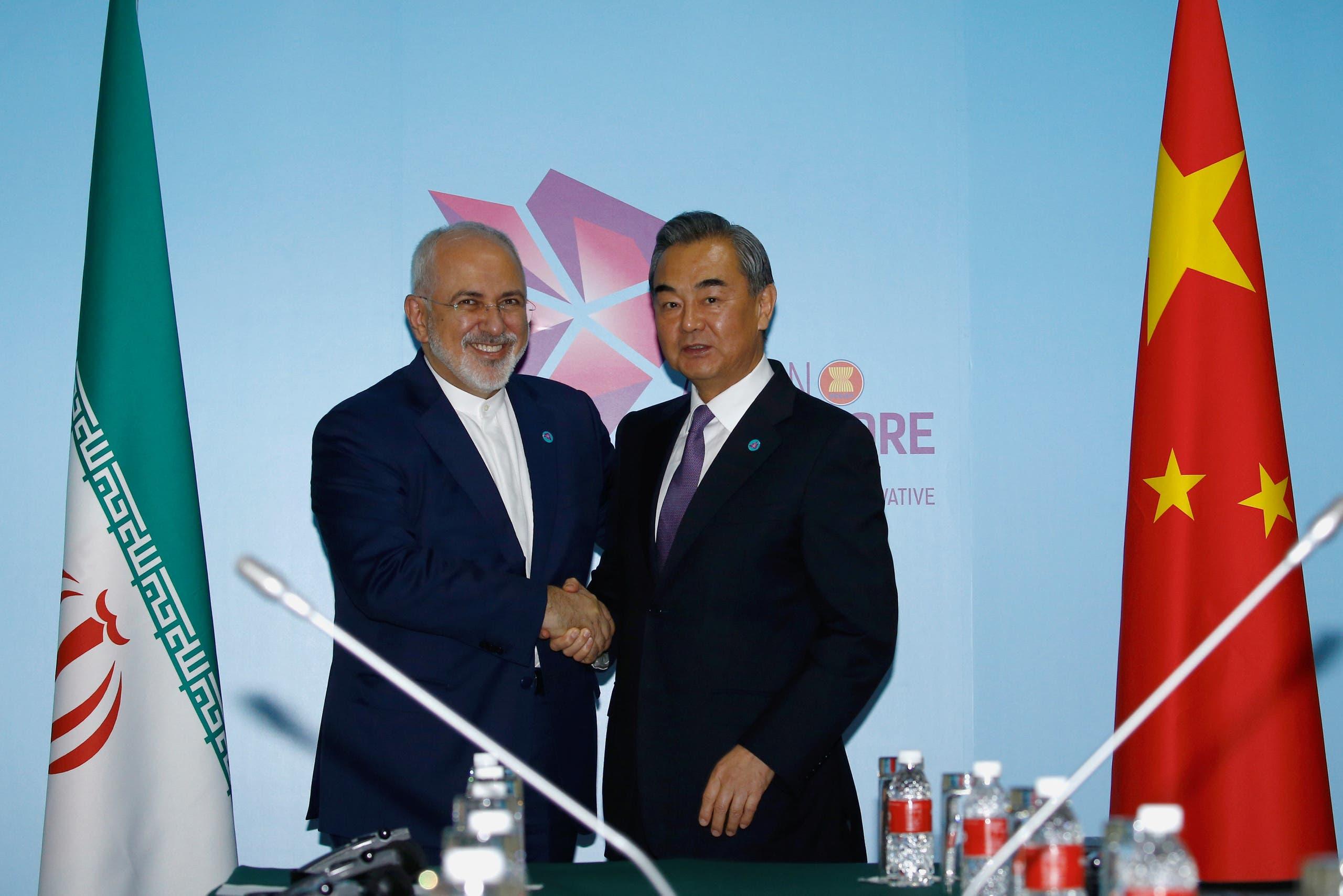 وزير الخارجية الإيراني مع نظيره الصيني في سنغافورة - أرشيفية