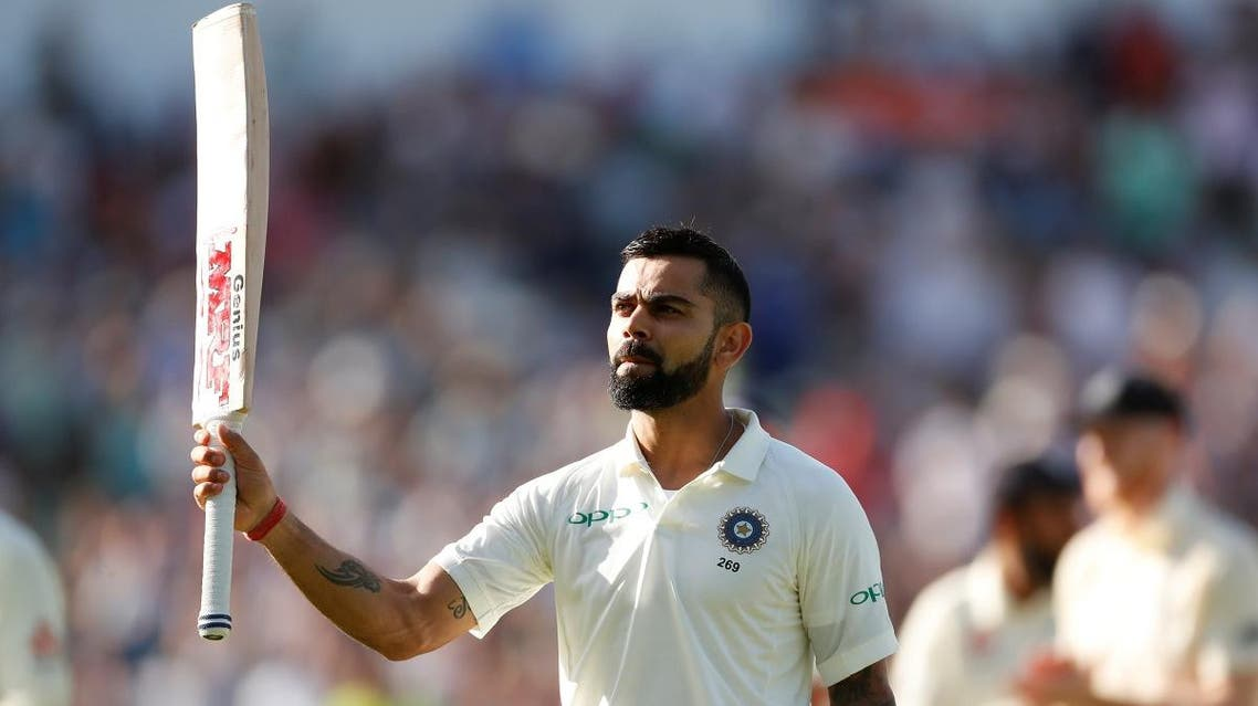 Virat Kohli salutes the fans as he walks off the pitch after losing his wicket in the first innings of the first Test at Edgbaston, Birmingham, against England. (Reuters)